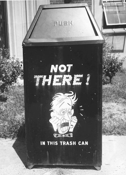 """Black and white photo of a trash can that read, """" Not There! In this trash can."""""""