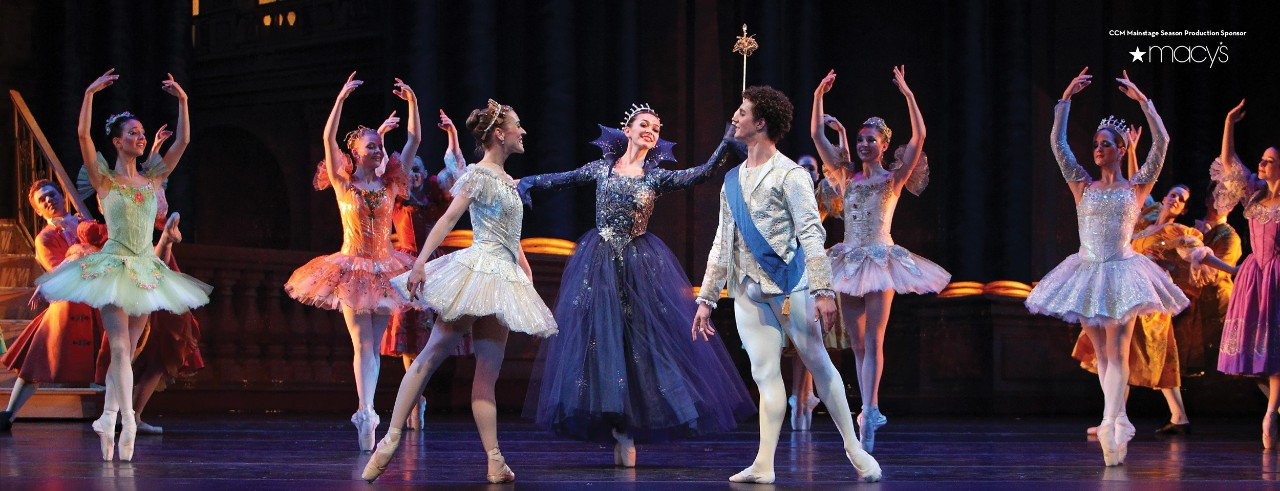 Cinderella and Prince Charming dancing with the Fairy Godmother.