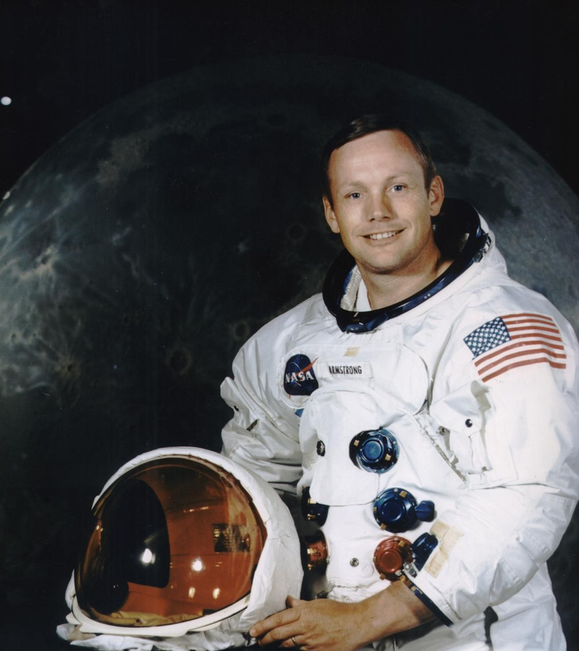 A portrait of astronaut Neil Armstrong in his spacesuit.