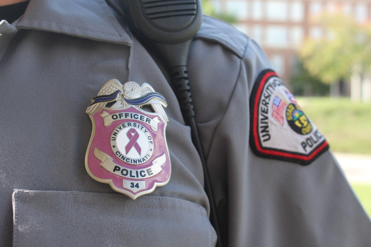 A UCPD officer wears the new, pink badge the department purchased for Breast Cancer Awareness Month.
