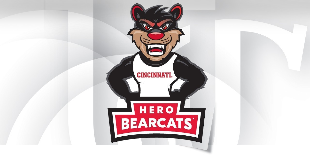 Graphic design of a Bearcat mascot standing behind a red banner reading Hero Bearcats