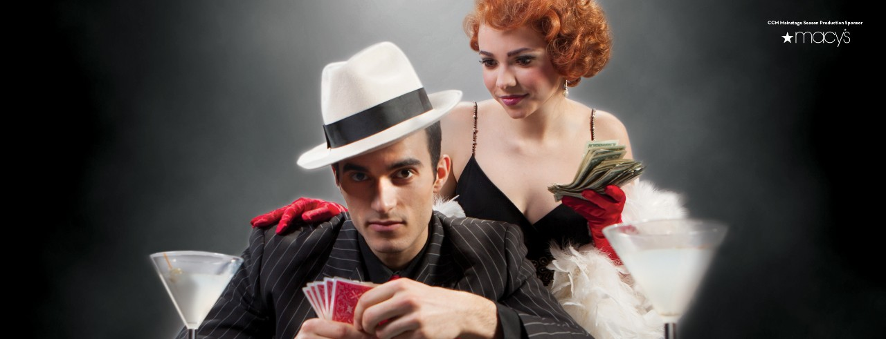 Man playing poker while a woman stands behind him and looks at his cards.