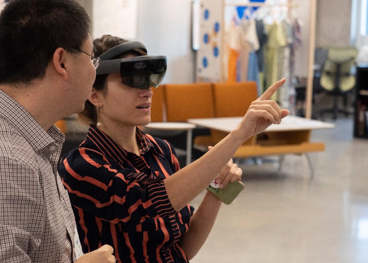 Woman wears a virtual reality headset