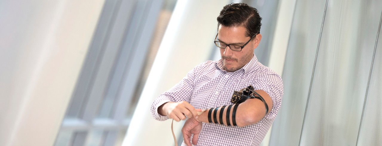 Jack Rubinstein, MD, offers a layman's demonstration of tefillin.