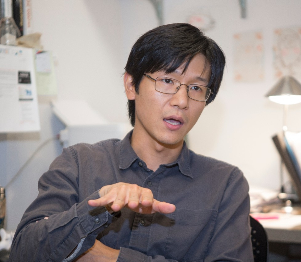 Takuya Konishi gestures while making a point in his office.