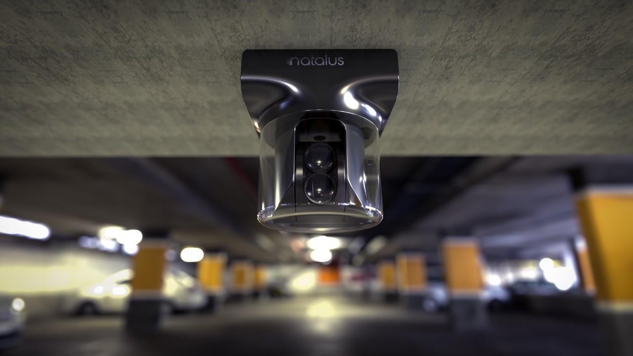 Natalus device hanging upside down in parking garage.