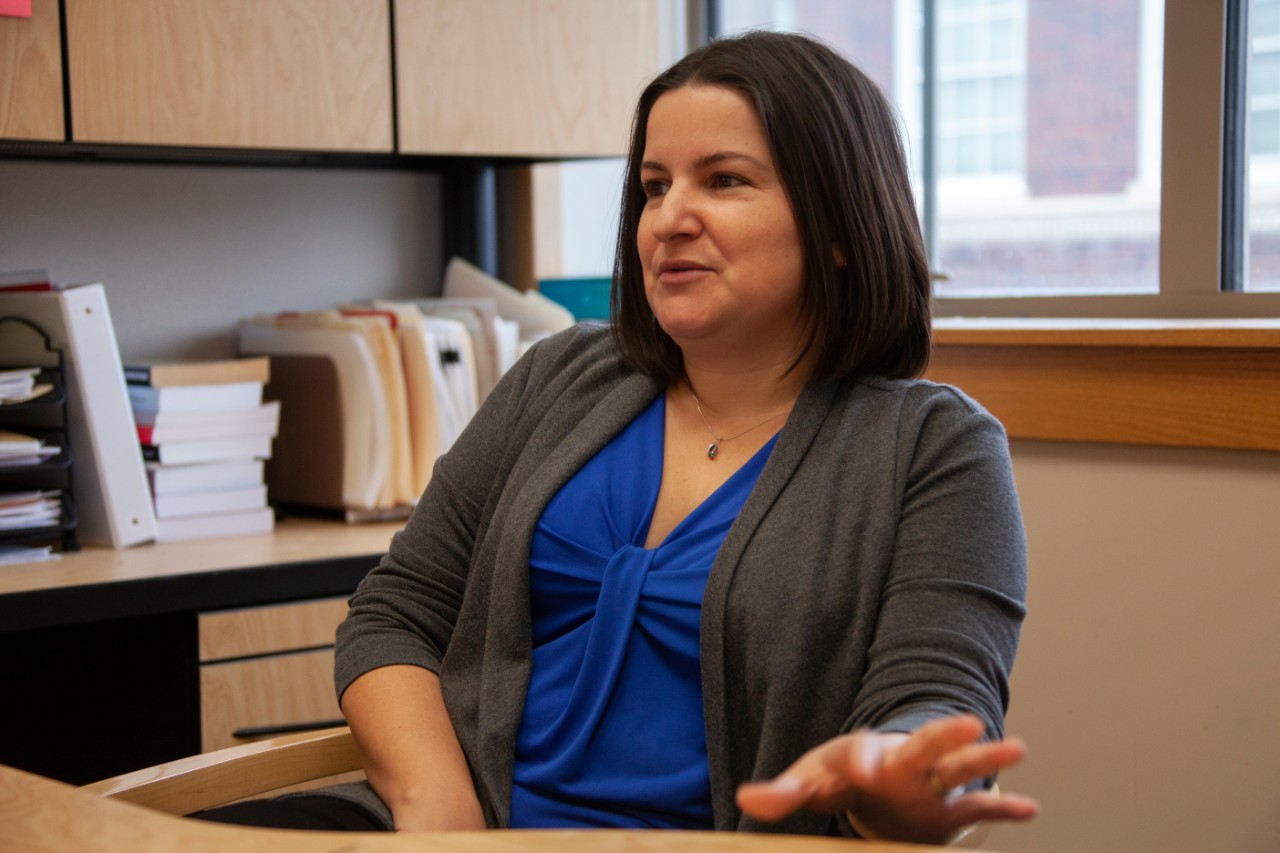 Leila Rodriguez talks at her office desk.