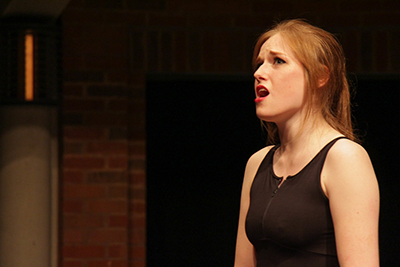 A high school voice student sings during CCM Prep's Year End Festival.