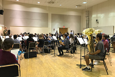 High school musicians rehearse for an upcoming orchestra performance.