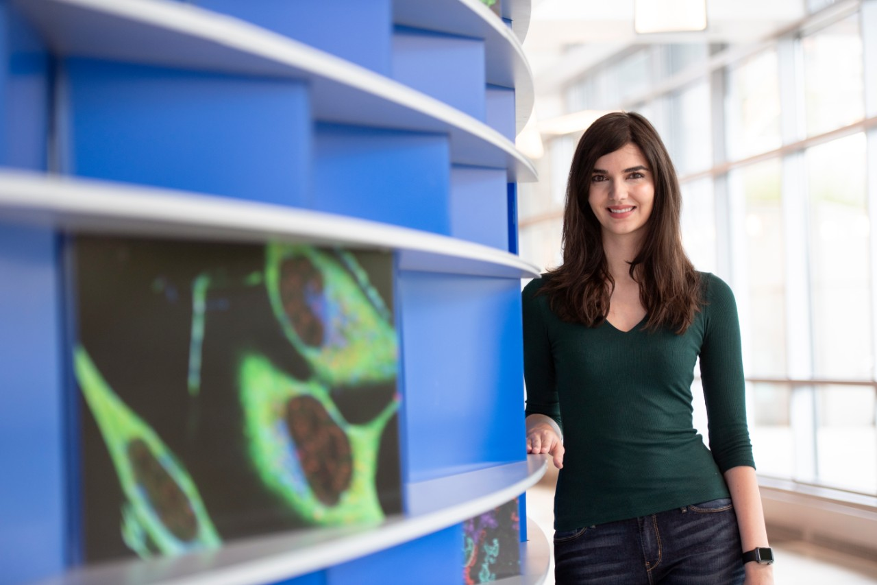 Christin Godale, a PhD student in neuroscience, stands in the lobby of Cincinnati Children's research pavilion