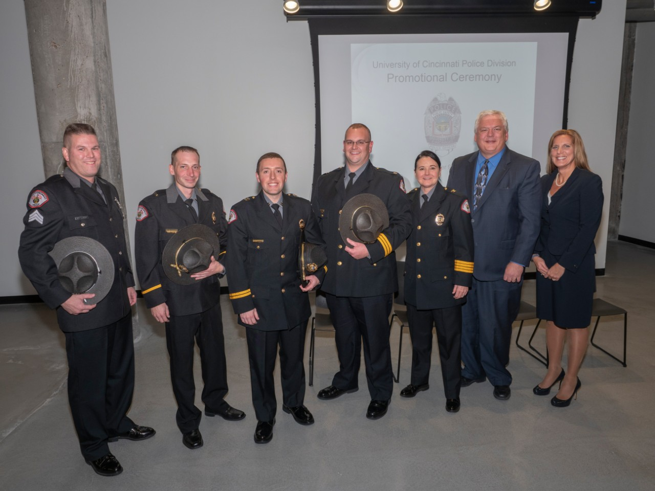 Vice President of Safety and Reform Robin Engel, Director of Public Safety James Whalen and UC Police Chief Maris Herold stand with the four newly promoted officer during a ceremony on Nov. 9.