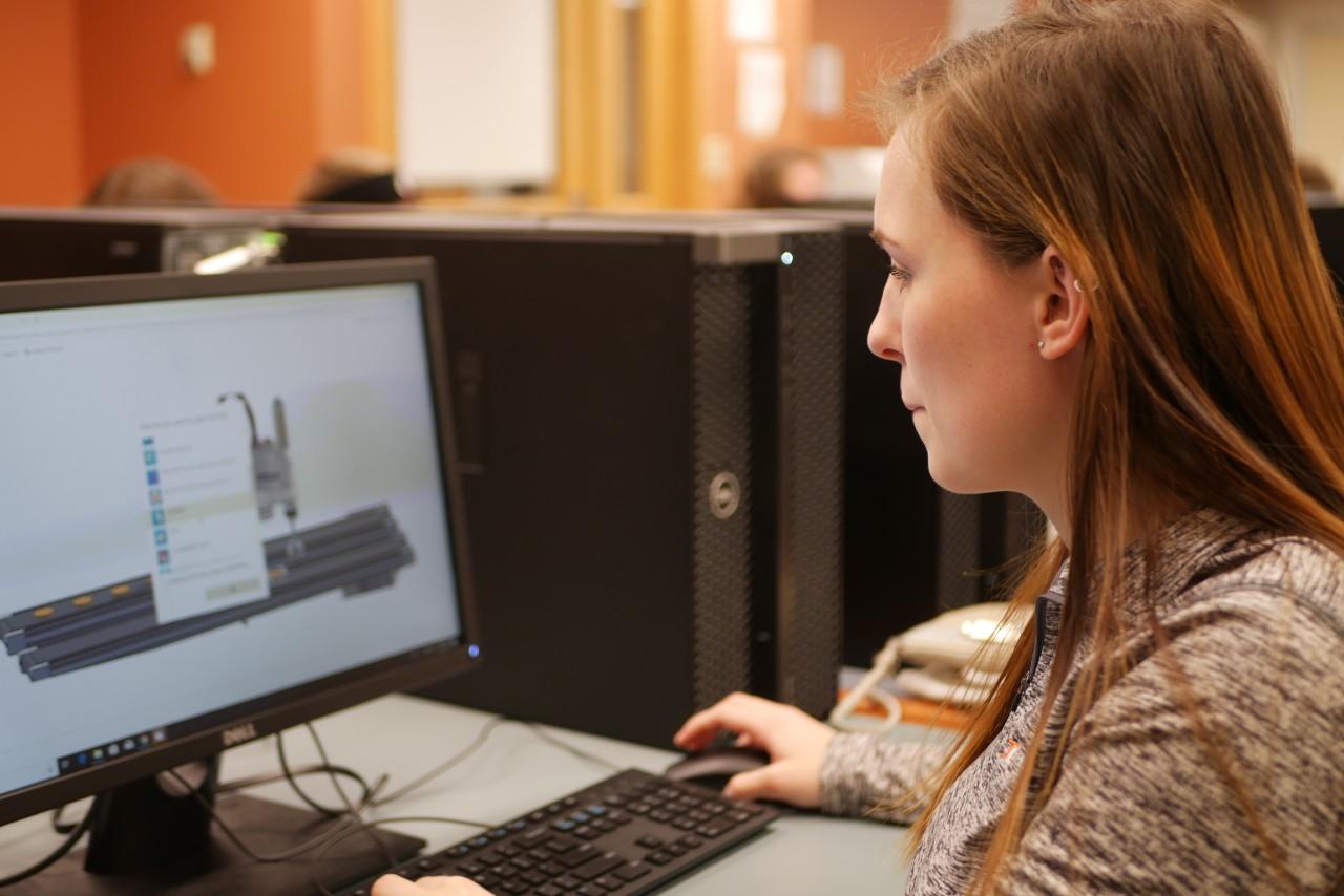 Ana Schauer on computer in a lab