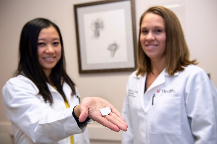 two physicians hold cancer patch