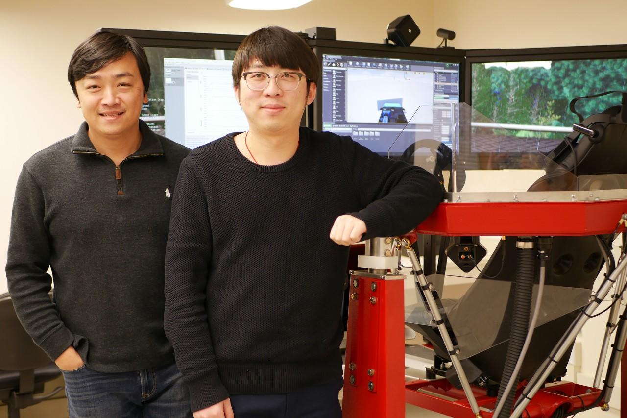 Ma and Wang pose next to driver simulator