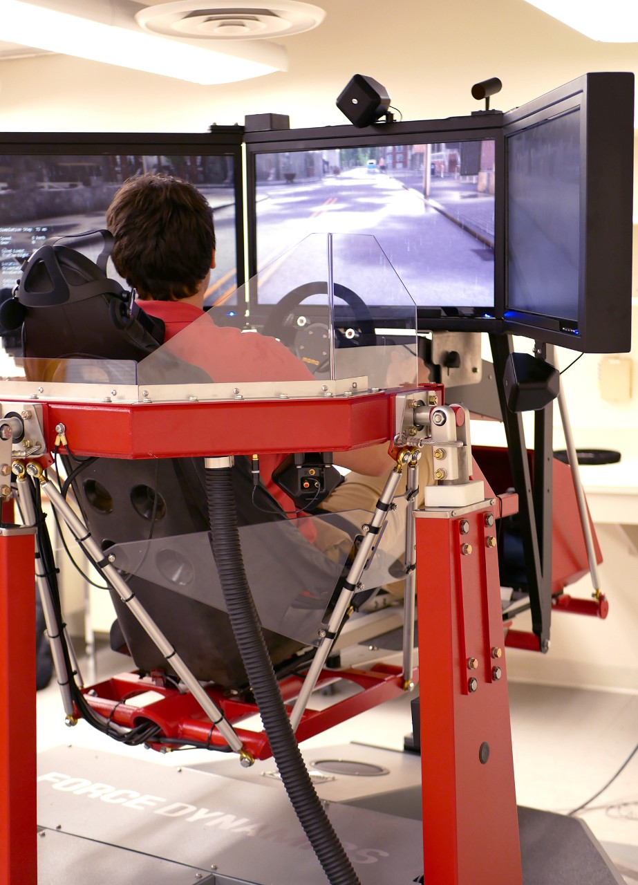student sitting in driver simulator