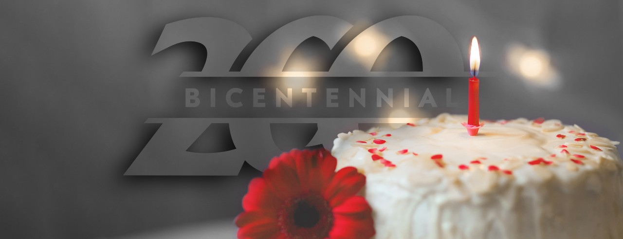 image of cake, a candle and the UC bicentennial logo