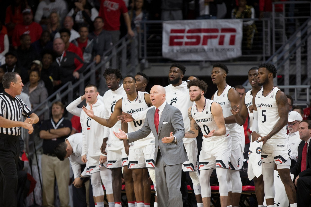UC men's basketball coach Mick Cronin argues a call with an official during a game.