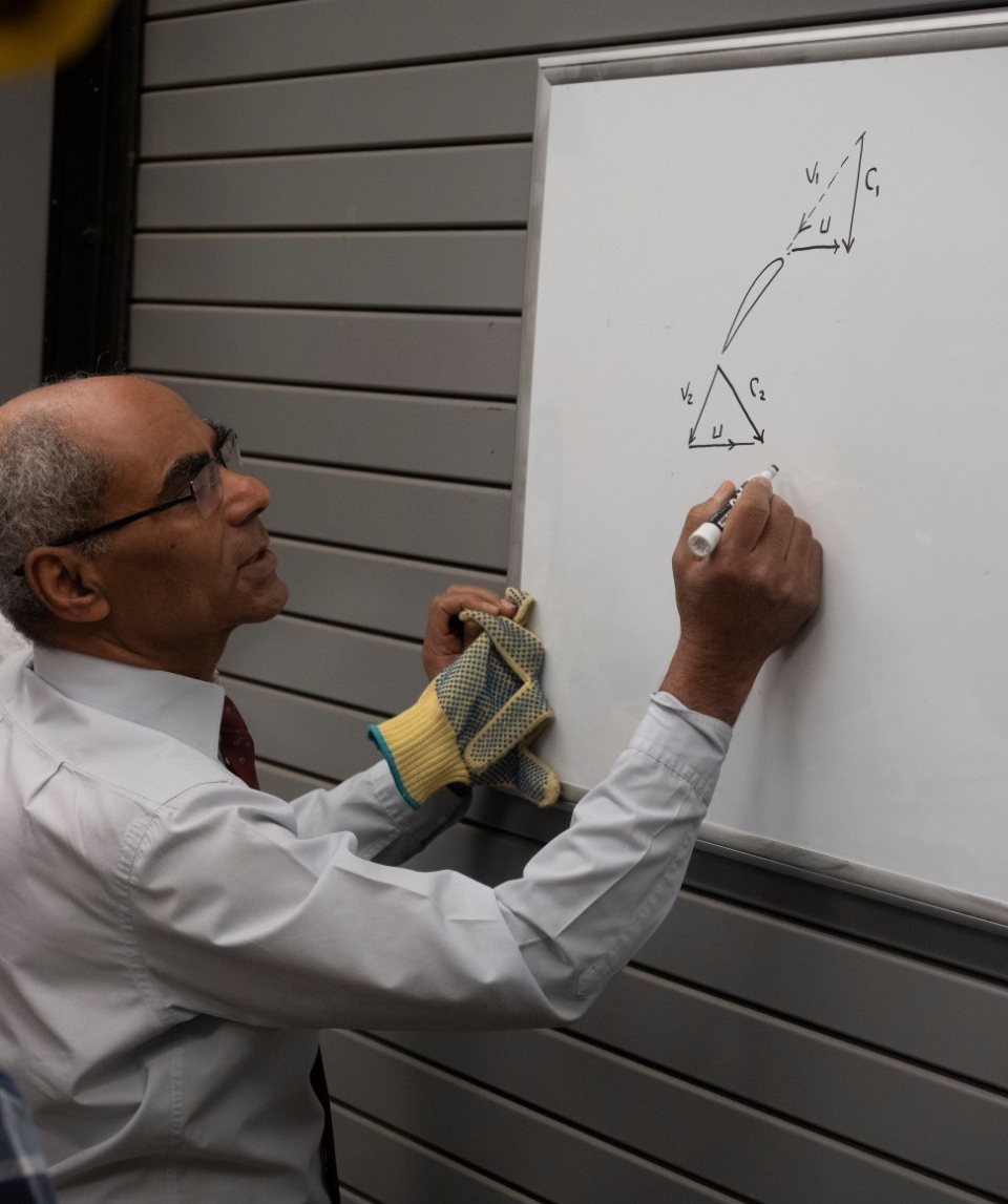 Shaaban Abdallah diagrams an engineering concept on a whiteboard in the UC Fly lab.