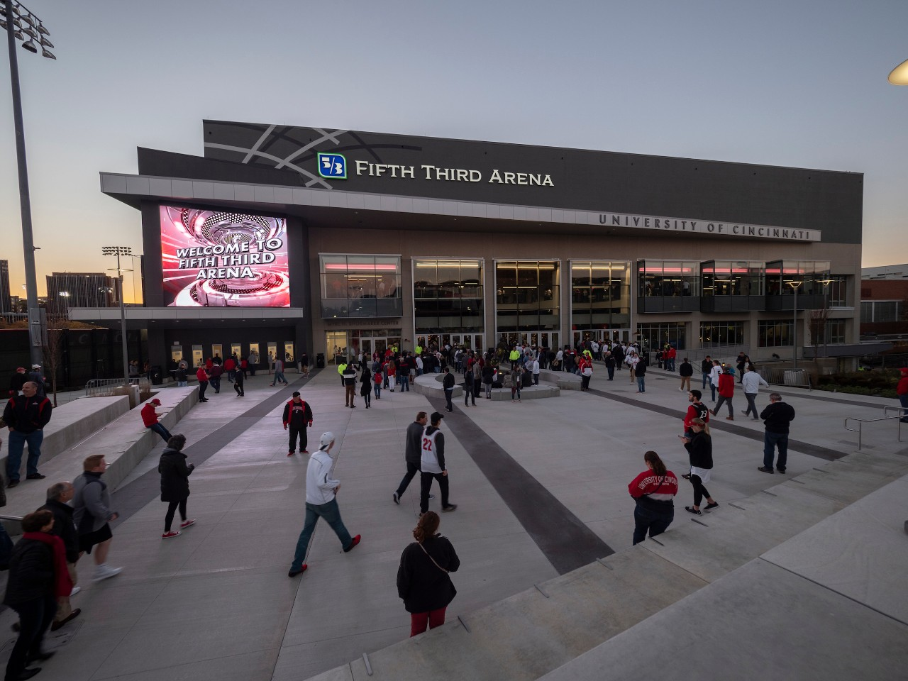 Fans walk toward UC's reopened Fifth Third Arena.