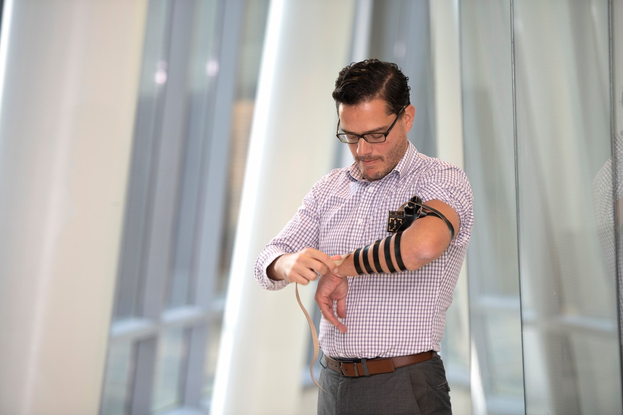 Jack Rubinstein illustrates the Jewish retual of wrapping the arm with Tefillin.