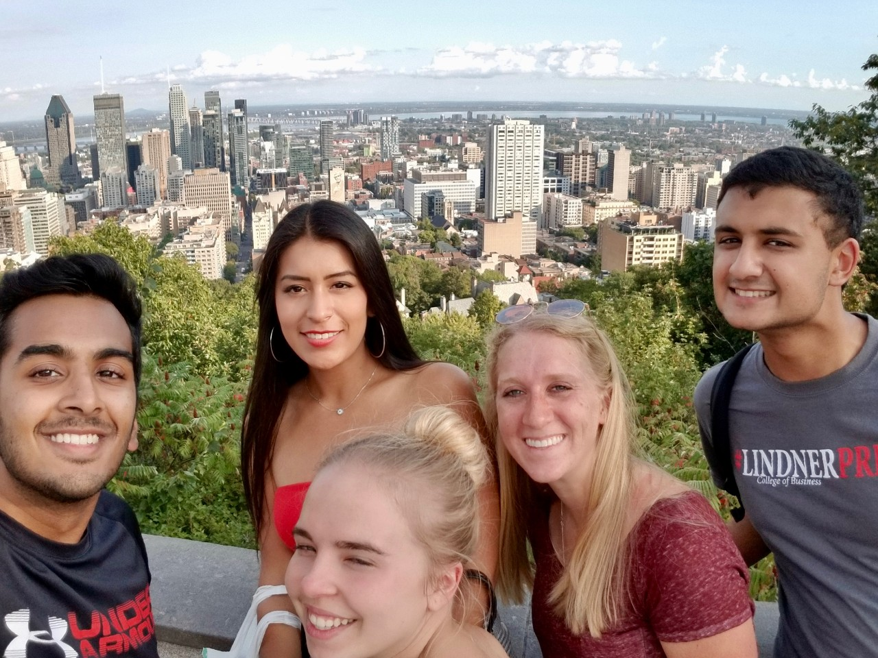UC students stand in front of downtown Montreal during their visit in 2018.