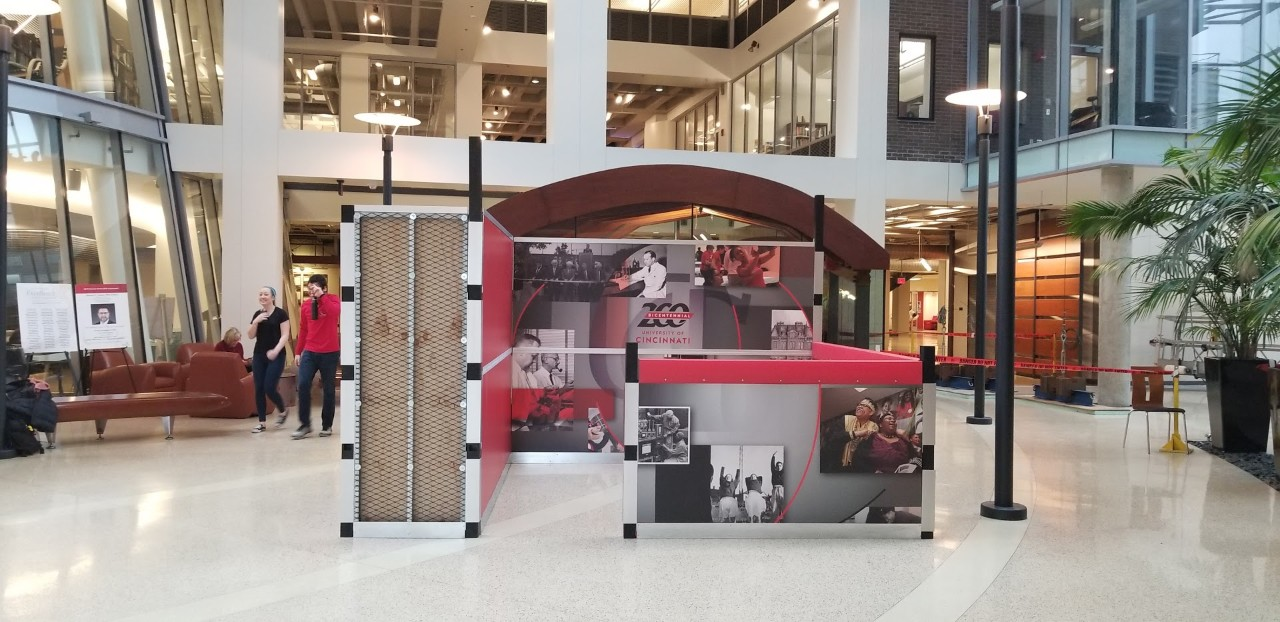 Booth with photos of UC history in an atrium