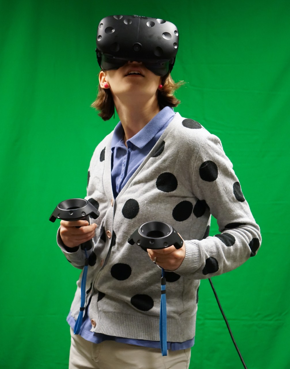 Student uses virtual reality headset and handheld controllers