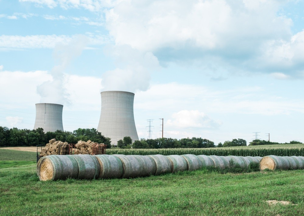 view of byron nuclear power plant cooling towers from farm