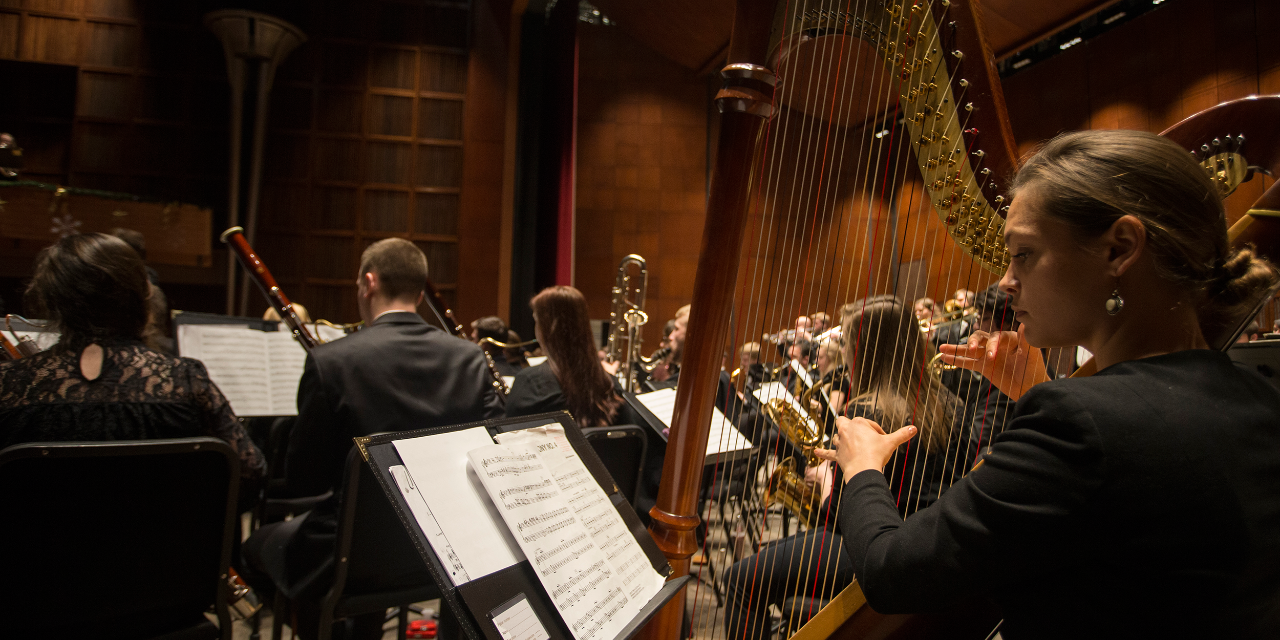 CCM wind students rehearse for an upcoming concert on stage at Corbett Auditorium.