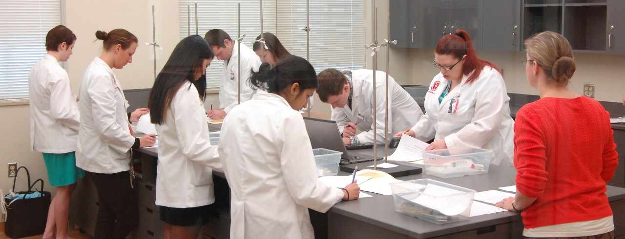 Pharmacy students in clinical skills lab at the James L. Winkle College of Pharmacy