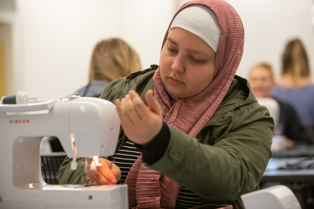 Student works on a sewing machine