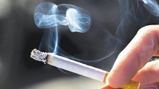 person holding cigarette