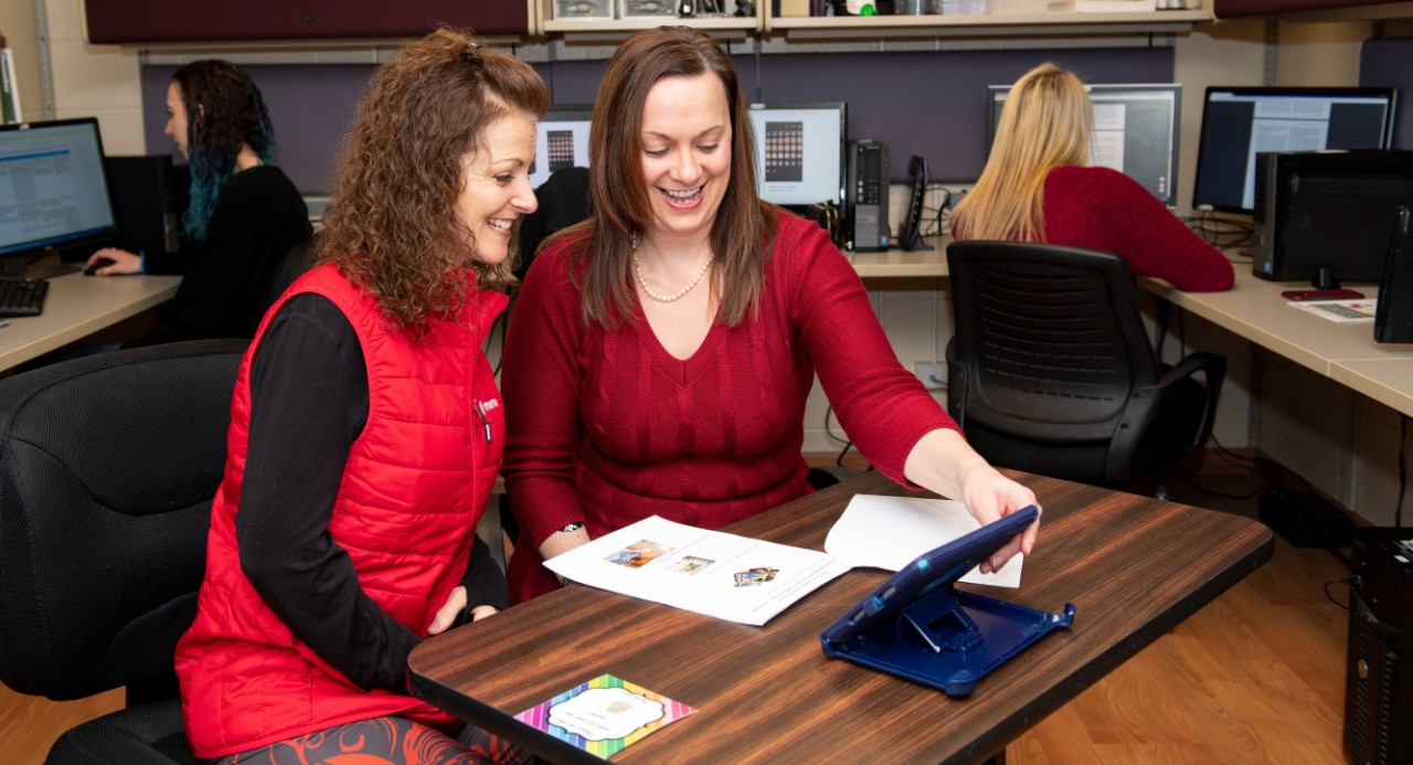 Terri Kersey, stroke survivor with aphasia, and Aimee Dietz of the College of Allied Health Sciences, working on a communication app on an iPad.
