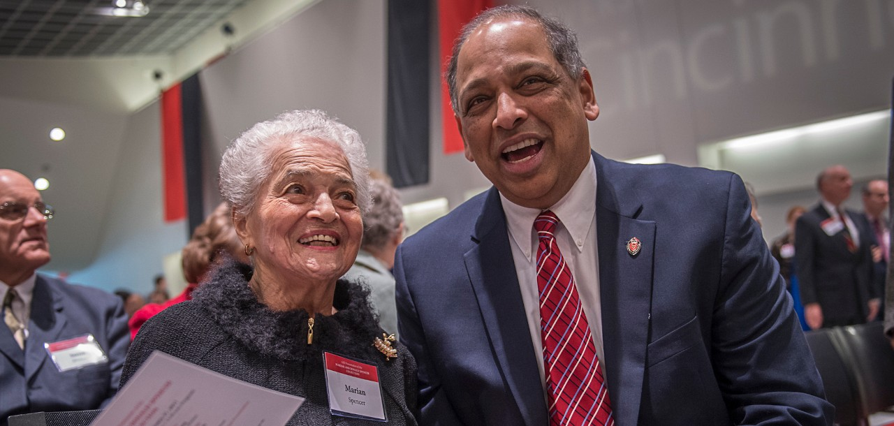 Marian Spencer and Presidet Neville Pinto talk during an event at the University of Cincinnati