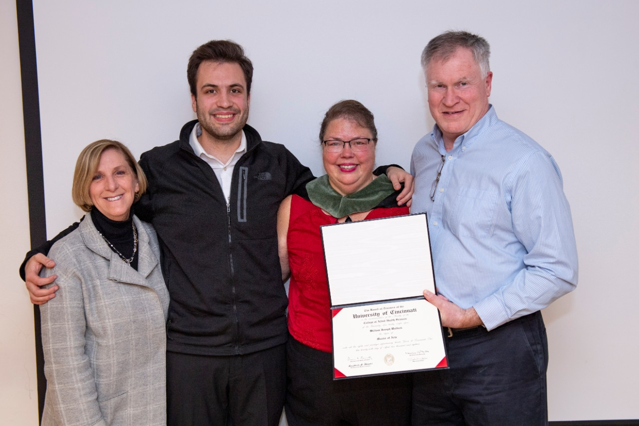 Dean Tina Whalen with the family of Bill Waldeck