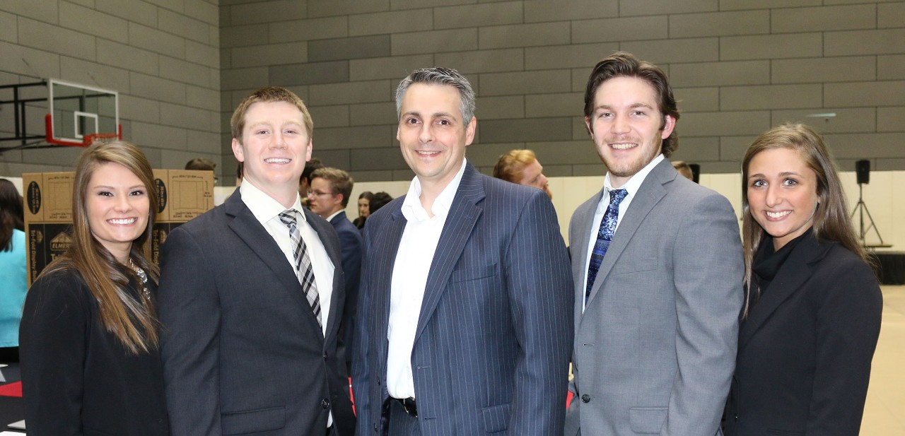 Thomas Dalziel, PhD (center) poses with student entrepreneurs at an IQ E-Pitch event