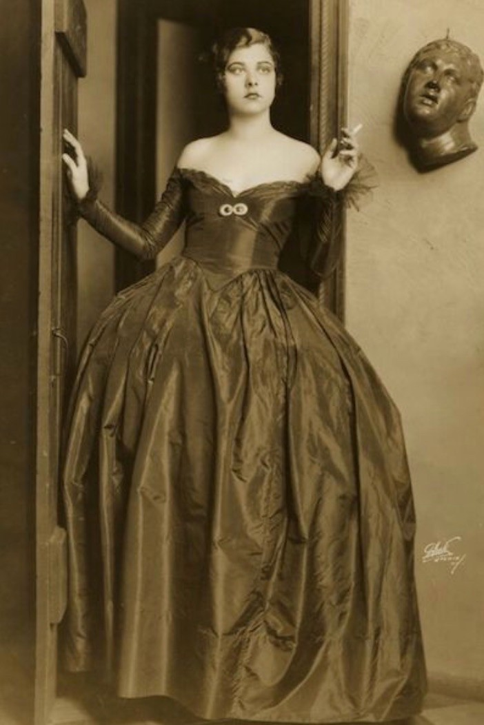 Libby Holman, 1923 UC grad dressed in formal gown holding a cigarette
