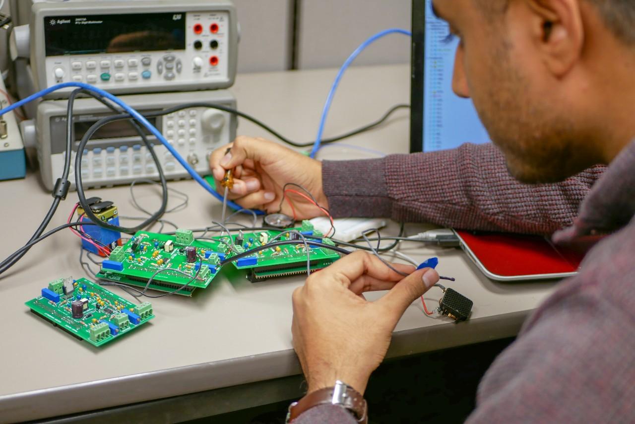 student works on hardware at desk