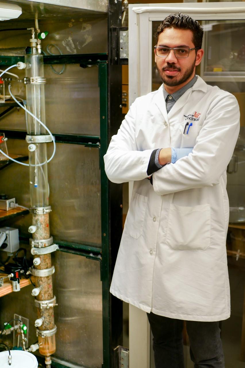 Dewidar poses in lab