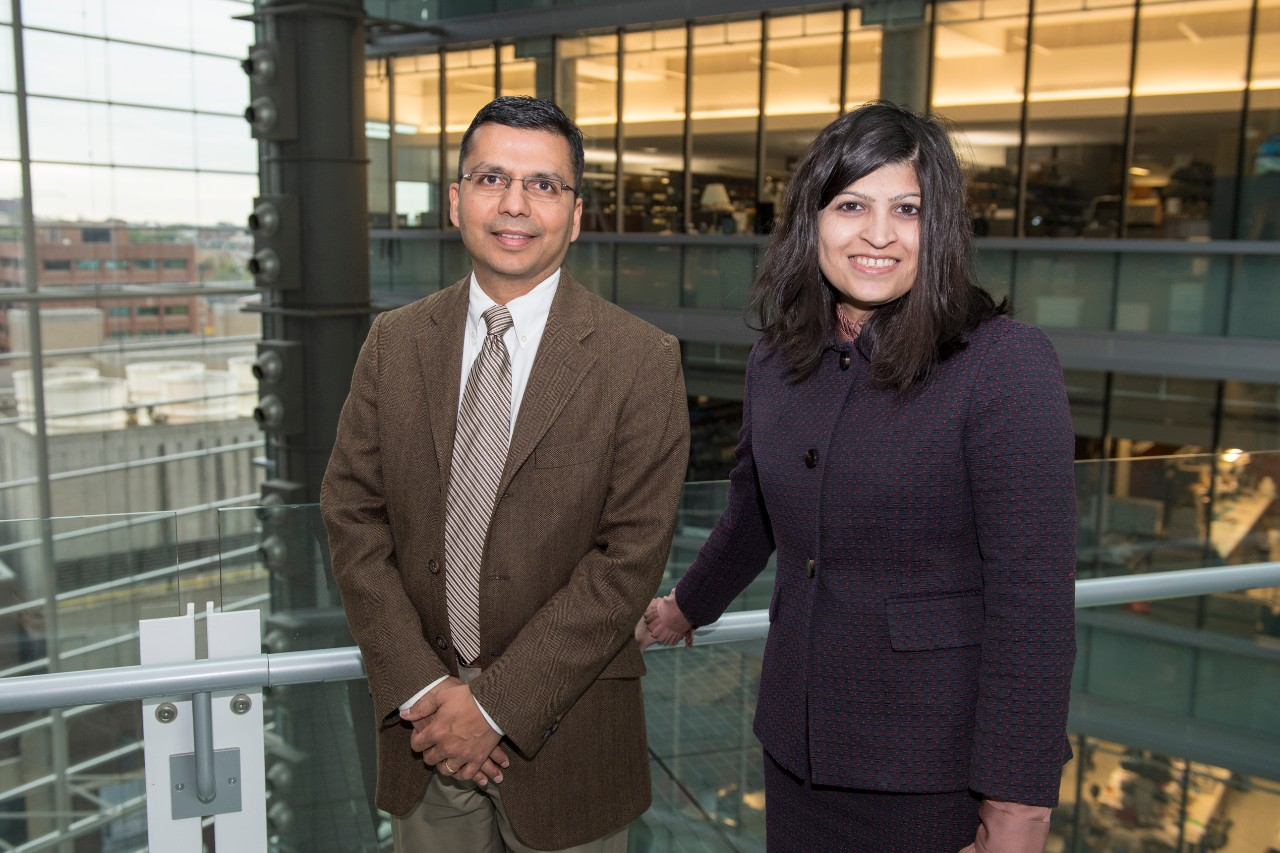 Dr. Charuhas Thakar and Dr. Silvi Shah, both of the Division of Nephrology on the bridge in CARE/Crawley