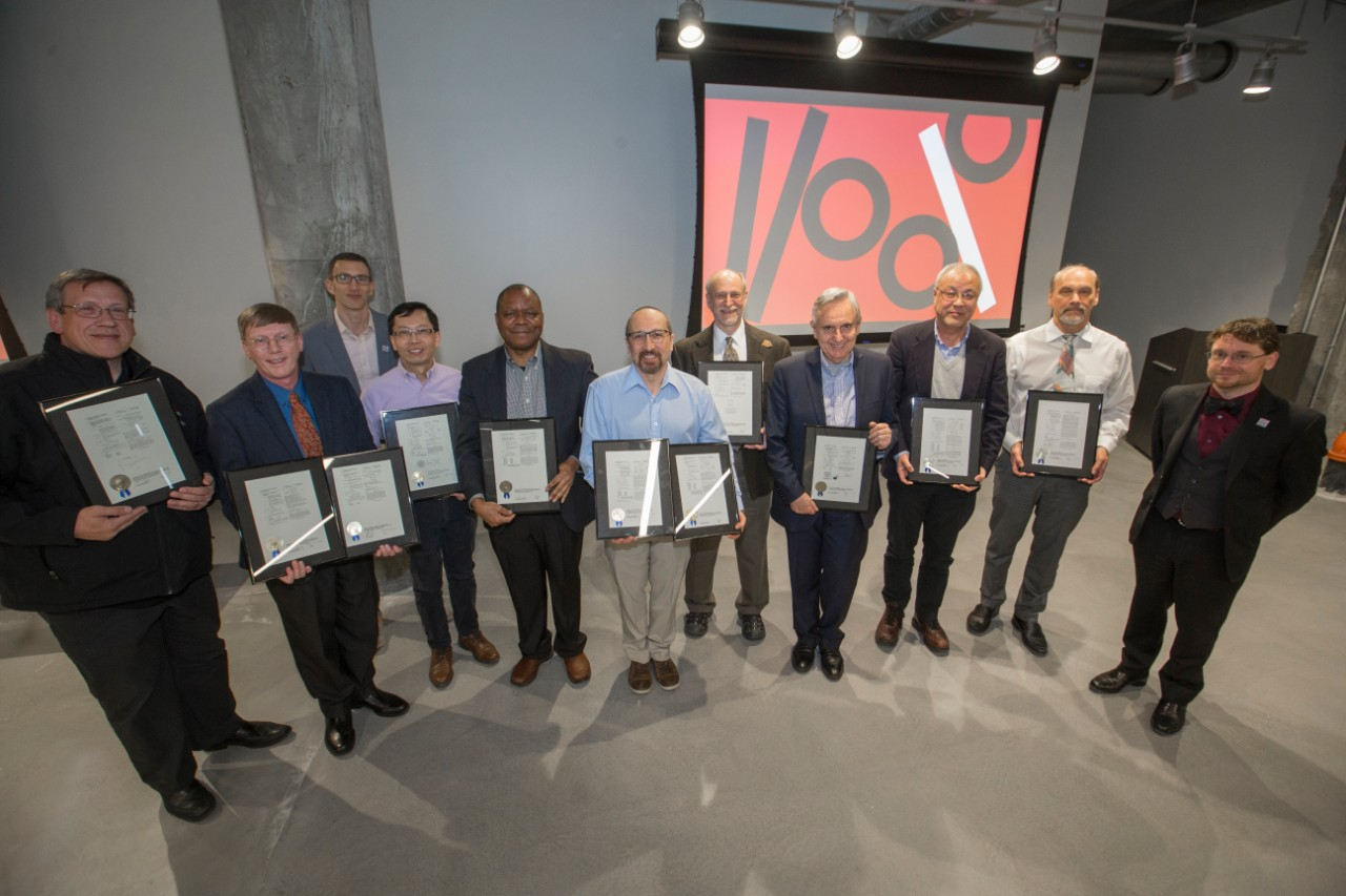 Ten UC faculty members display their U.S. patent certificates.