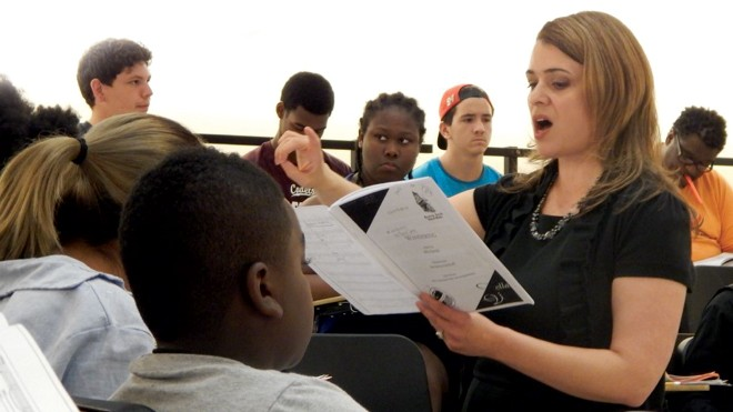 CCM faculty member Eva Floyd instruct a classroom of young music students.