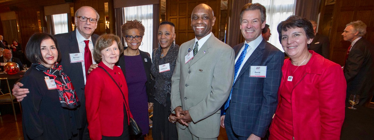 """Left to right Gail and Richard Friedman, UC Trustee Margaret K. """"Peg"""" Valentine, College of Law Dean Verna Williams,  Ohio State Rep. Catherine Ingram, Ohio state Sen. Cecil Thomas,  UC Chief Innovation Officer David Adams and Bicentennial co-chair Kim Dobbs, pose with with the UC 200 Bicentennial sign during the Bicentennial Commendation & Reception at the Athletic Club in Columbus, Ohio."""