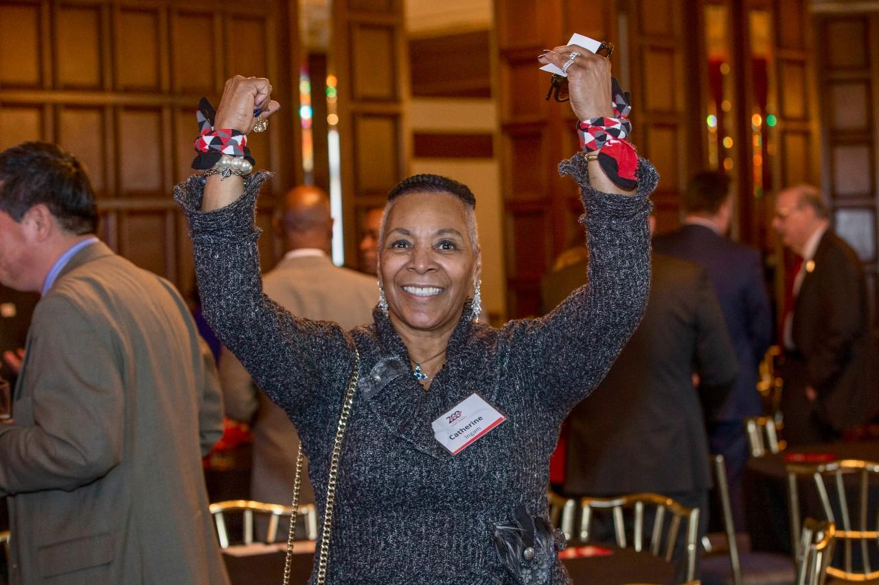 "Catherine Ingram, Ohio State representative gestured ""UC"" during the Bicentennial Commendation & Reception at the Athletic Club in Columbus, Ohio."