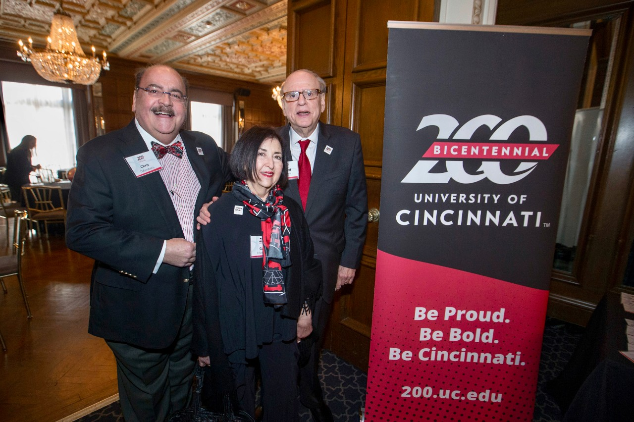 Left to right Chris Dalambakis, Gail and Richard Friedman posed with with the UC 200 Bicentennial sign during the Bicentennial Commendation & Reception at the Athletic Club in Columbus, Ohio. UC/Joseph Fuqua II