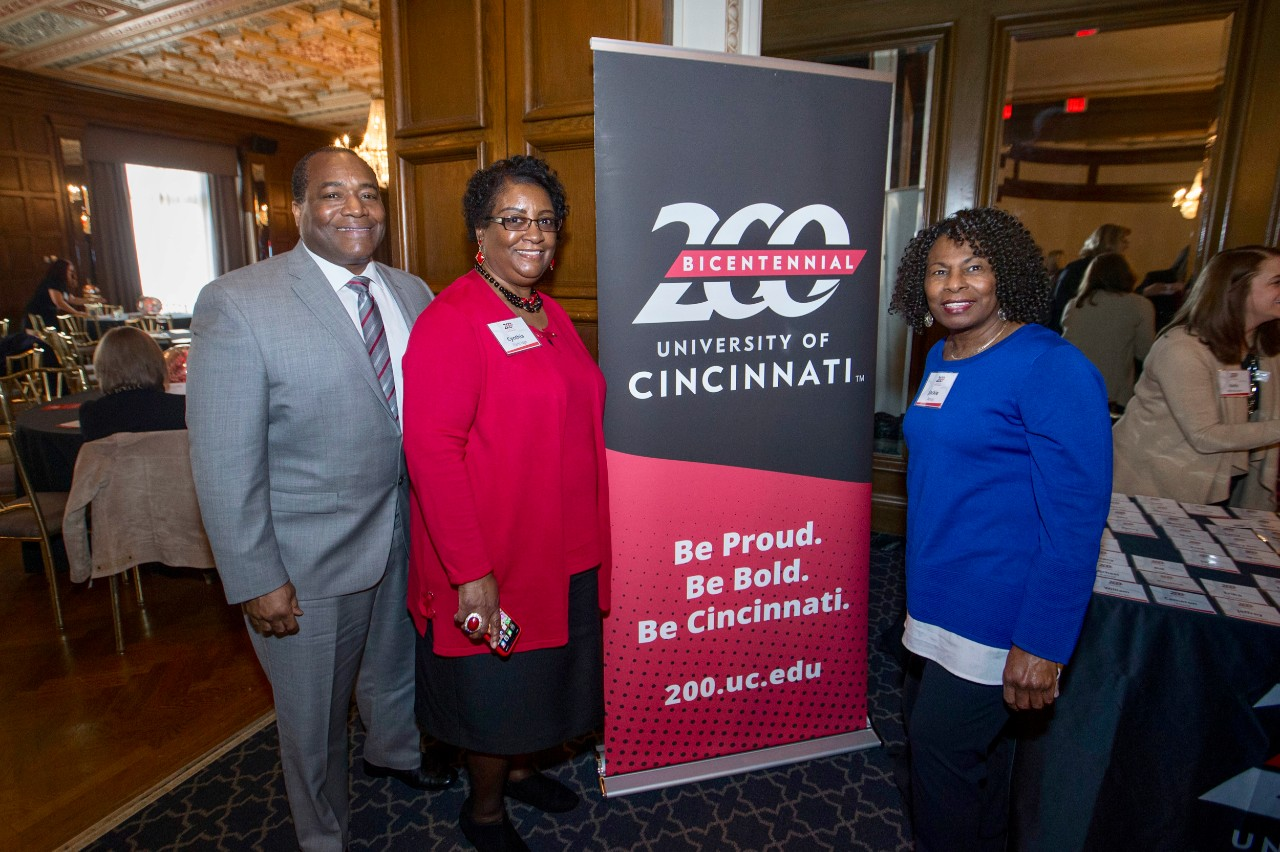 Left to right Brian and Cynthia Partridge and Jackie Amos posed with with the UC 200 Bicentennial sign during the Bicentennial Commendation & Reception at the Athletic Club in Columbus, Ohio. UC/Joseph Fuqua II