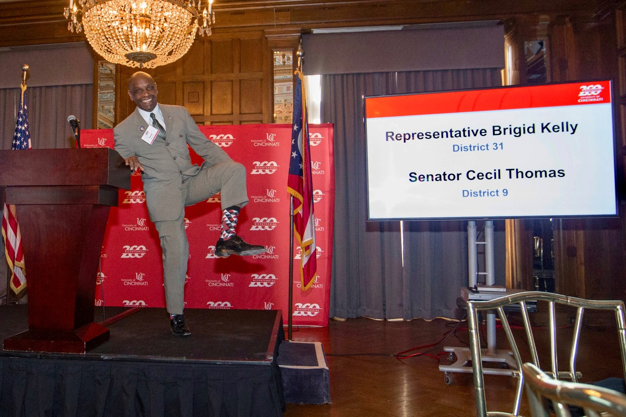 Cecil Thomas, Ohio state Senator shown off his UC socks during the Bicentennial Commendation & Reception at the Athletic Club in Columbus, Ohio.