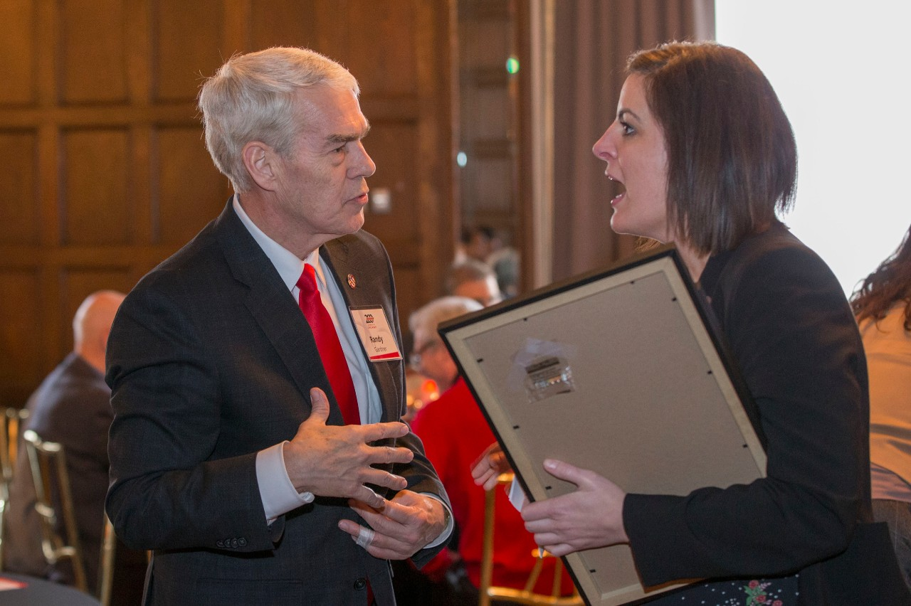 Chancellor Randy Gardner, left spoke with Briget Kelly, Ohio State representative during the Bicentennial Commendation & Reception at the Athletic Club in Columbus, Ohio.