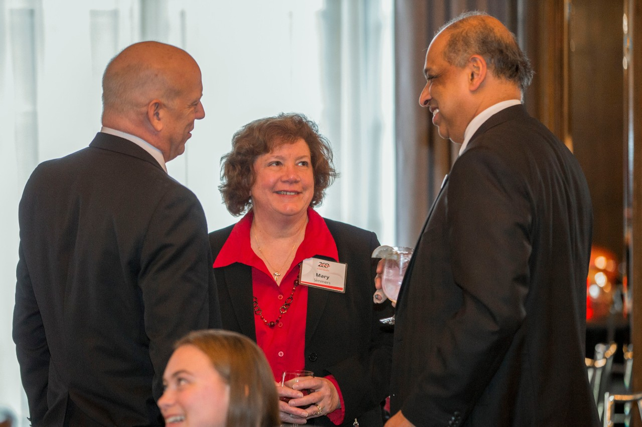 Left to right Scott and Mary Simmer spoke with Neville G. Pinto, left University of Cincinnati president during the Bicentennial Commendation & Reception at the Athletic Club in Columbus, Ohio.