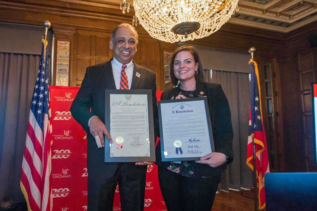 Neville G. Pinto, left University of Cincinnati president and Briget Kelly, (right) Ohio State representative posed with two proclamations during the Bicentennial Commendation & Reception at the Athletic Club in Columbus, Ohio. UC/Joseph Fuqua